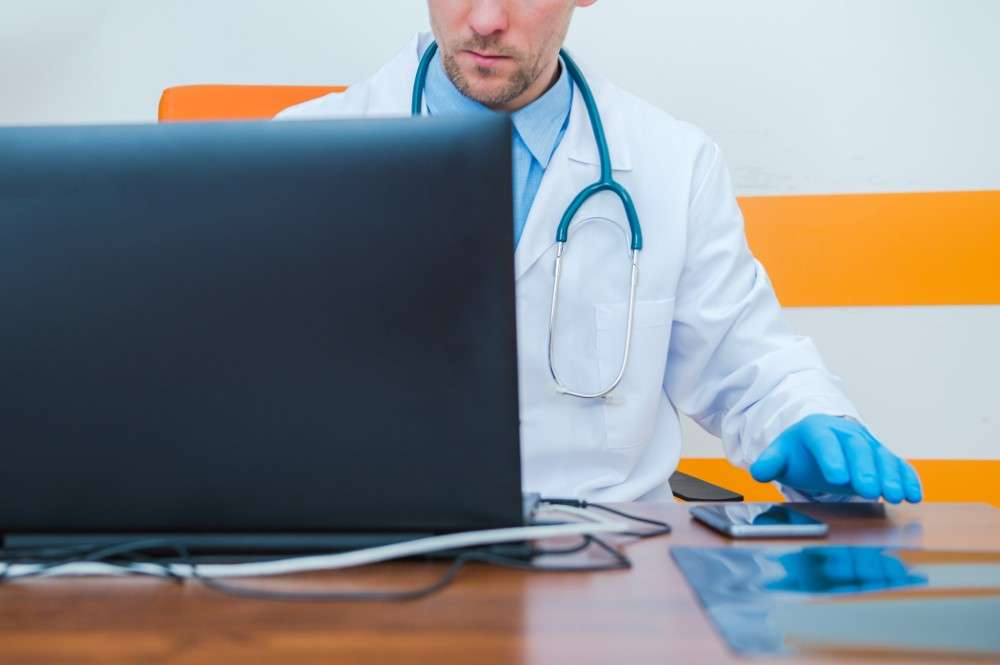 doctor at laptop
